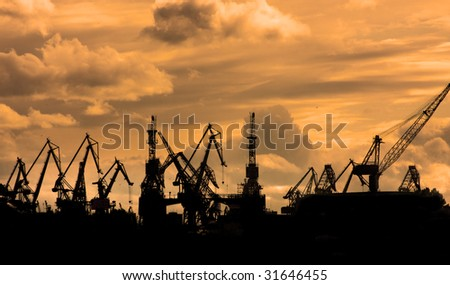 Silhoueete of sea port cranes in the morning, St.Petersburg, Russia