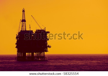 Silhouete of an Oil Rig - stock photo