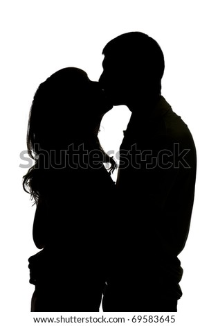 silhouette a happy couple holding and kissing each other - stock photo