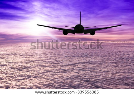 silhouette air plane flying with nice sky - stock photo