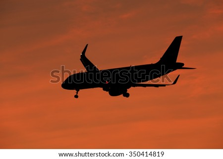 Silhouette, Airplane in the sky - stock photo