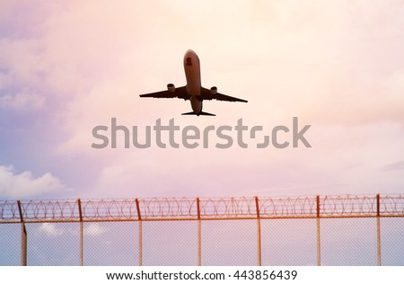 silhouette Airplane taking off in airport