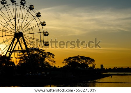 Silhouette amusement park at the lake