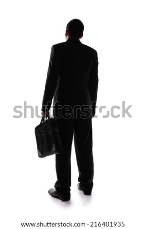 silhouette back view of a business man look to copy space, asian - stock photo