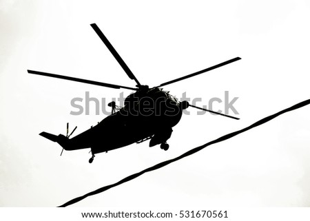 silhouette background of military helicopter