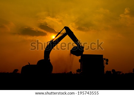 Silhouette Backhoe  - stock photo