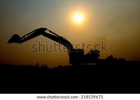Silhouette Backhoe - stock photo