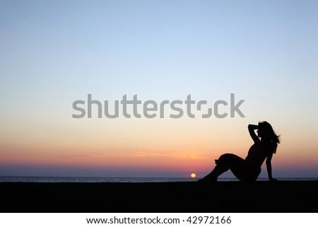 silhouette beautiful woman on beach - stock photo
