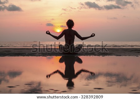 Silhouette beautiful yoga and meditation background. - stock photo
