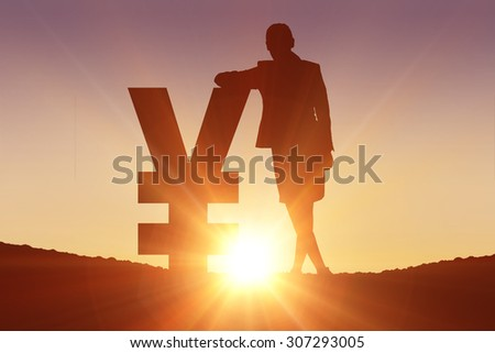 Silhouette beside yen symbol against clouds - stock photo