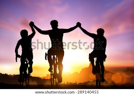 Silhouette bicycle on sunset and Friendship in bicycle sport and triathlon sport  - stock photo