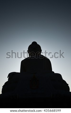 Silhouette big Buddha image in a temple at phuket,thailand - stock photo