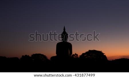 silhouette Big Golden Buddha at Wat Muang in Ang Thong, Thailand - stock photo