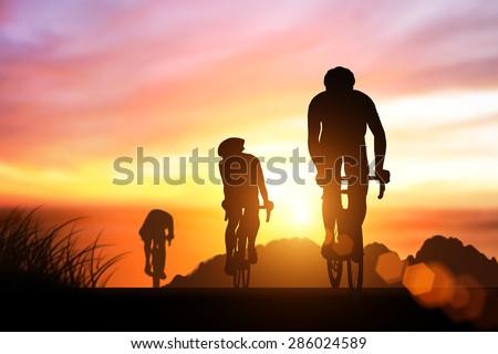 silhouette bike on sunset - stock photo