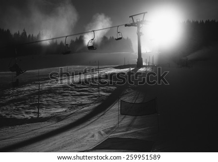 Silhouette black and white photo of ski slope at Austrian Alps at sunny day - stock photo