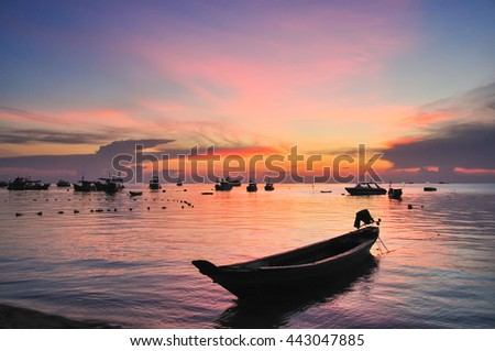 Silhouette boat on sunset sea and clot of sky at Koh Samui, Surat Thani, province southern Thailand. - stock photo