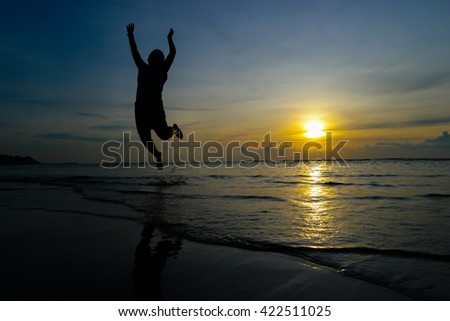 silhouette Boys jumps. Background sunset on the sea