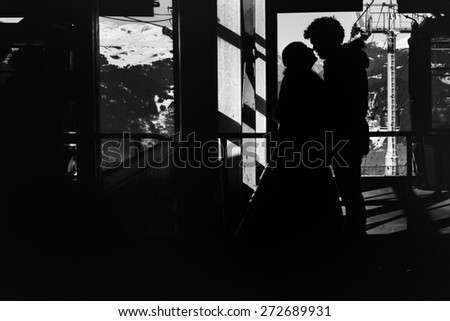 silhouette bride and groom in love in the room on the background of the Alps Courchevel - stock photo