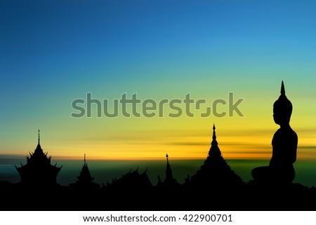 Silhouette Buddha image sunset background. - stock photo