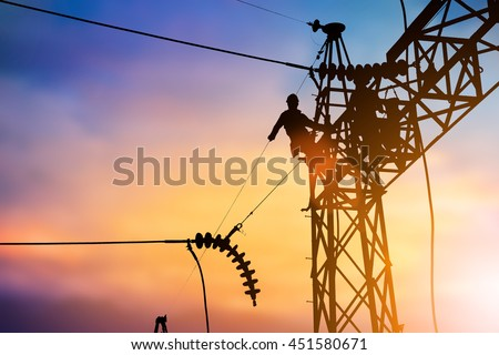 Silhouette Business Industrial Electrician for the installation of electrical systems for alternative energy over blurred pastel background sunset.Heavy industry and Transportation and People concept. - stock photo