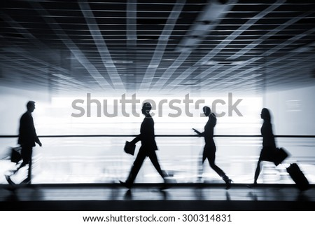 Silhouette business people walking on the background of the large windows - stock photo