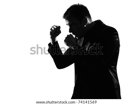 silhouette caucasian business man boxing gesture  expressing behavior full length on studio isolated white background