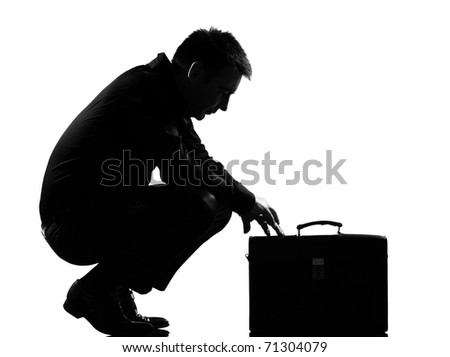 silhouette caucasian business man  expressing fatigue despair tired behavior briefcase  full length on studio isolated white background - stock photo