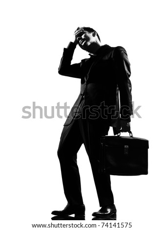 silhouette caucasian business man  expressing fatigue despair tired behavior full length on studio isolated white background - stock photo