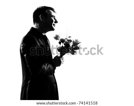 silhouette caucasian business man offering flowers expressing behavior full length on studio isolated white background - stock photo