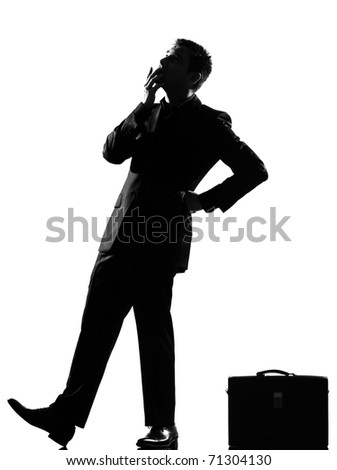silhouette caucasian business man thinking pensive behavior  looiking up full length on studio isolated white background - stock photo