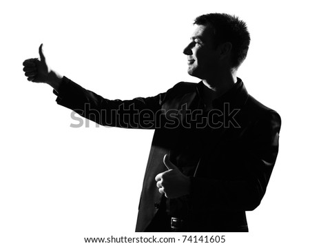 silhouette caucasian business man thumbs up  expressing winning behavior full length on studio isolated white background - stock photo