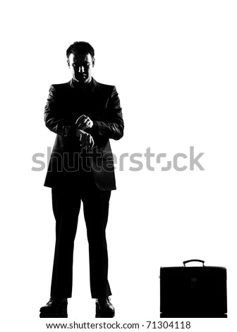 silhouette caucasian business man  waiting checking the time full length on studio isolated white background - stock photo
