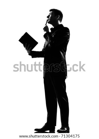 silhouette caucasian business man with note pad thinking expressing behavior full length on studio isolated white background - stock photo