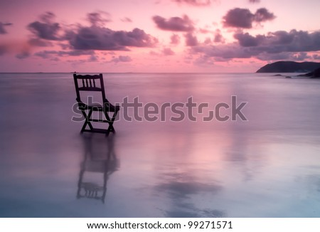 silhouette chair at sunset. - stock photo