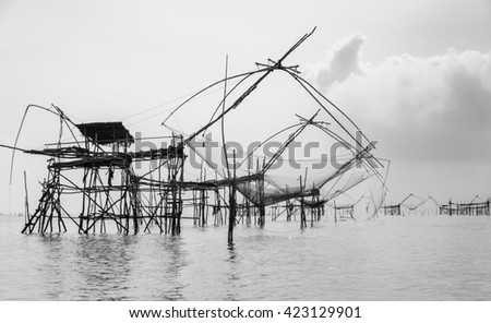 Silhouette Chinese fishing nets or shore operated lift nets in Phatthalung, Thailand. Black and white color image - stock photo