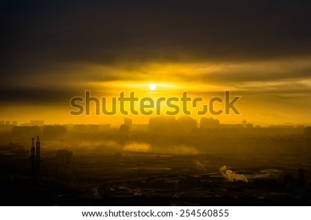 Silhouette city and sun - stock photo