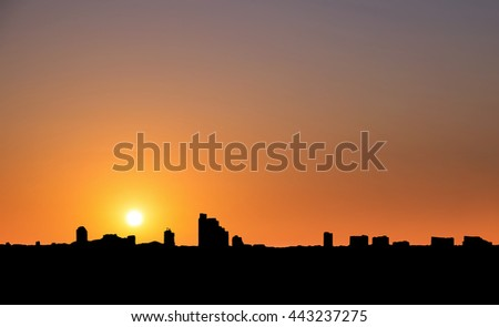Silhouette, city in sunset with clear sky in tropical country