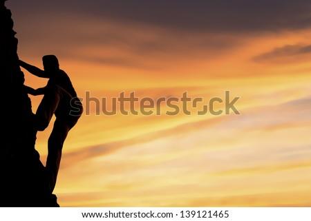 Silhouette  climbing - stock photo
