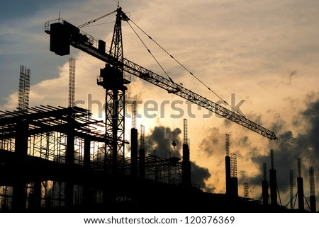 silhouette Construction site at sunset - stock photo