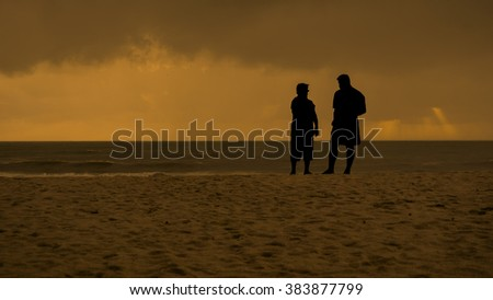 silhouette couple were relaxing on the beach