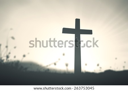 Silhouette cross on blurred amazing light sunset with amazing light background. Merry Christmas Card, Thankful, Repentance, Reconcile, Adoration, Glorify, Peace, Evangelical, Hallelujah, Amen concept - stock photo
