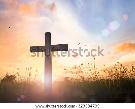 Silhouette cross on blurred beautiful autumn sunset with amazing light background. Christmas, Worship, Mercy, Humble, Repentance, Reconcile, Adoration, Glorify, Peace, Evangelical, Hallelujah concept. - stock photo