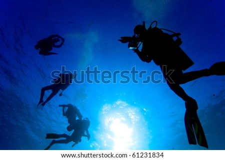 Silhouette diver's safety stop - stock photo
