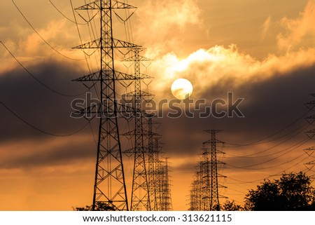 Silhouette electrical power tower with sunlight and cloud - stock photo