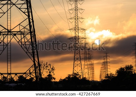 Silhouette electrical power tower with sunlight and cloud