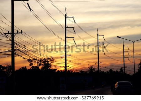 Silhouette electricity pole and sunset sky wallpaper background