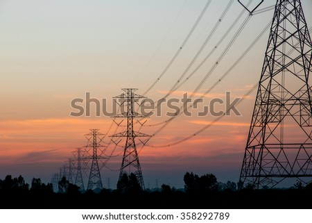 silhouette electricity station over Blurred electricity