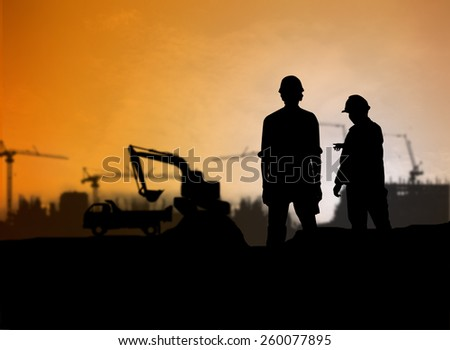 silhouette engineer looking Loaders and trucks in a building site over Blurred construction worker on construction site - stock photo