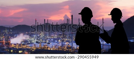 Silhouette engineers are standing orders The oil refining industry - stock photo