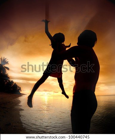 silhouette family of child hold on father hand with sea view.